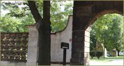 Stone arch, fence and large trees